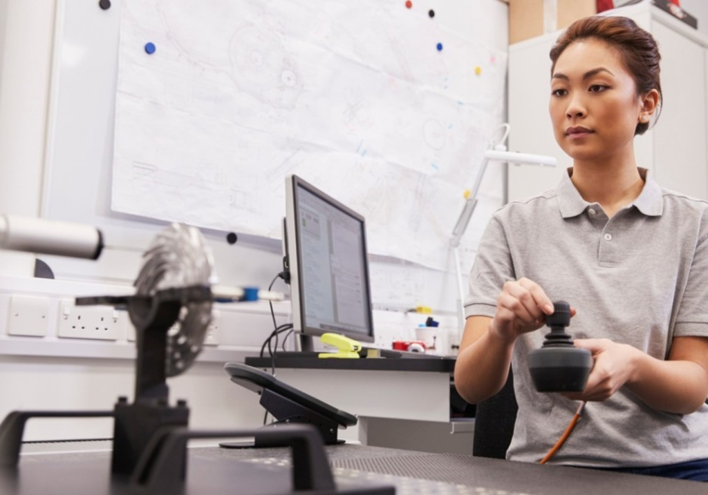 Female Engineer Uses CMM Coordinate Measuring Machine
